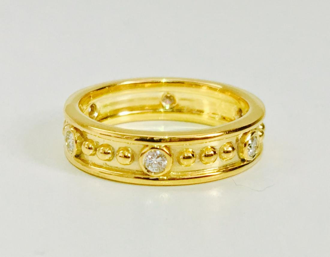 18K gold, 0.48 CT diamond band. VS clarity and G color.