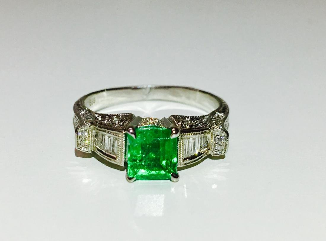 14k white gold. 1.5ct Emerald and Diamond Ring