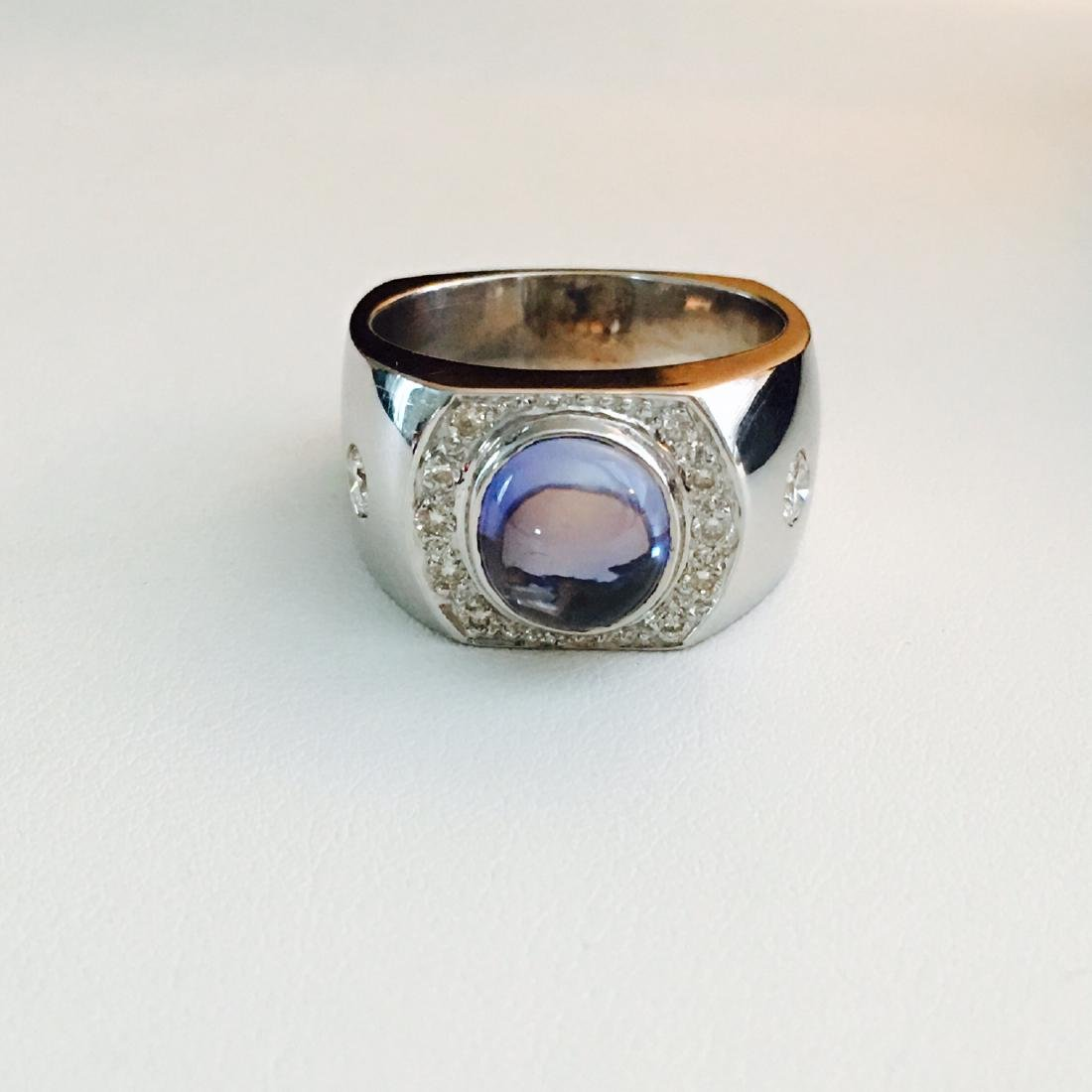 3.50 CT Blue Sapphire, VVS Diamonds in 18k gold ring.
