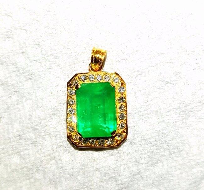 21k Gold, 19 Carat Emerald and Diamond Pendant.