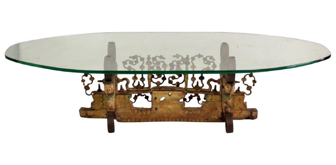 FIGURAL CARVED GLASSTOP COFFEE TABLE