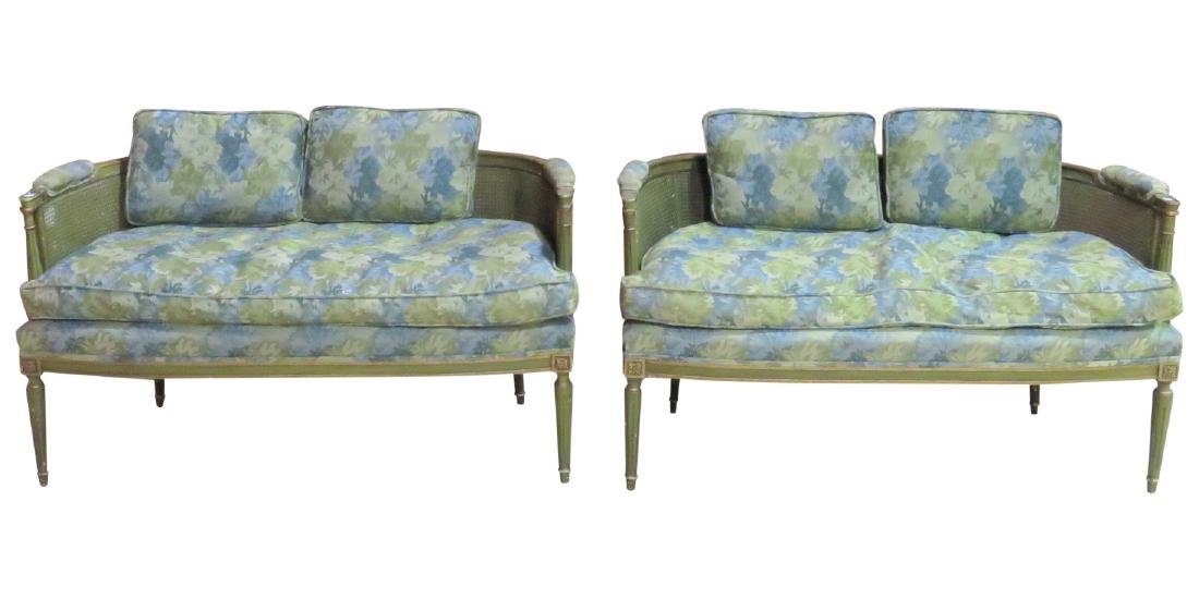 Pair GREEN PAINTED UPHOLSTERED CANED BACK SETTEES