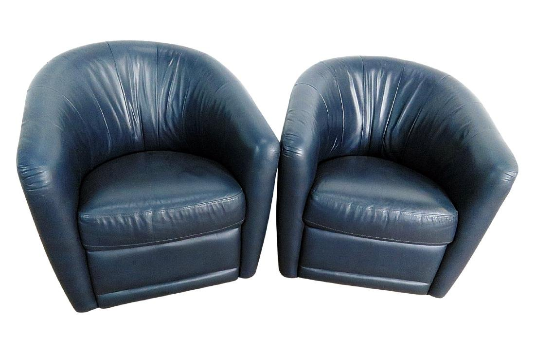 Pair NATUZZI BLUE LEATHER SWIVEL CHAIRS