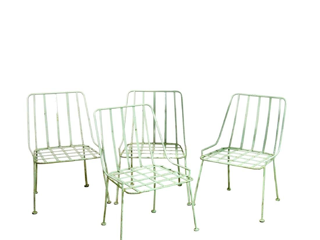 FOUR WROUGHT IRON DINING CHAIRS attributed WOODARD