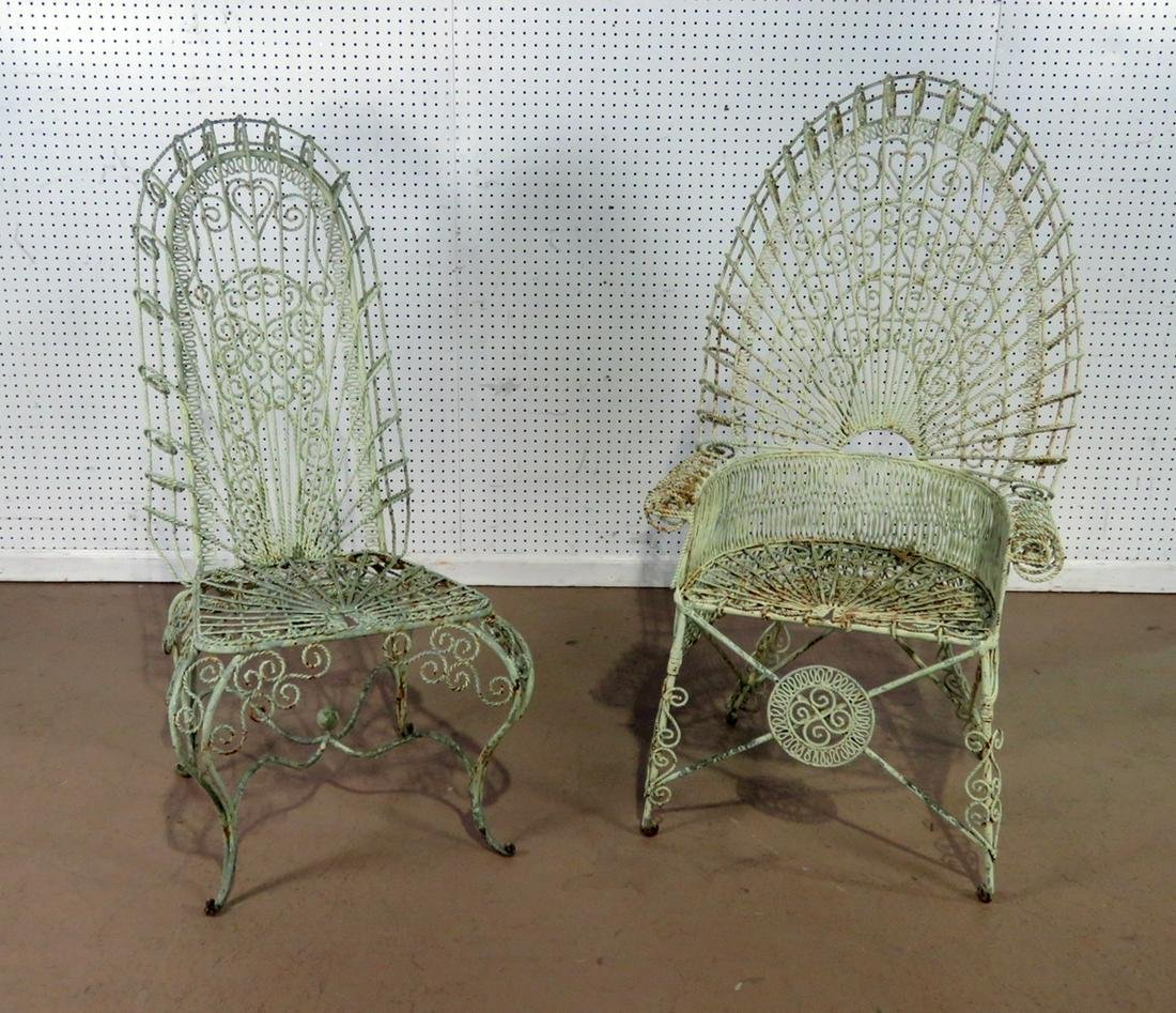 PAIR ORNAMENTAL WROUGHT IRON CHAIRS