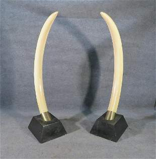 PAIR FAUX LIFE SIZE TUSK SCULPTURES AFTER REDMILE