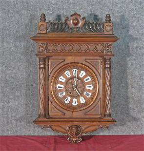 CARVED FIGURAL WALL CLOCK ATTRIBUTED BERMAN
