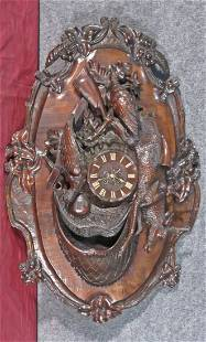 BLACK FOREST CARVED FIGURAL WALL CLOCK