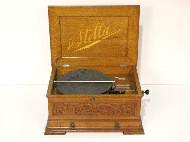 12: ANTIQUE STELLA OAK MUSIC BOX w/ 66 DISKS