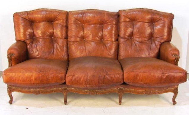 FRENCH CARVED LEATHER SOFA