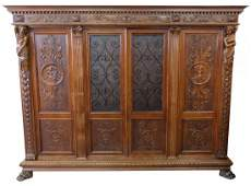 19th c CONTINENTAL FIGURAL CARVED WALNUT BOOKCASE