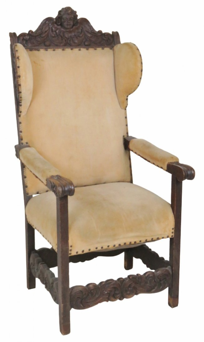 ANTIQUE CARVED WALNUT WING CHAIR