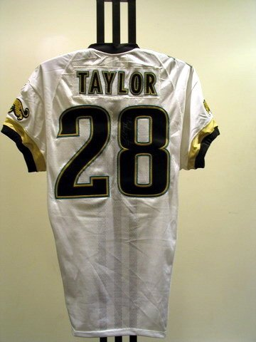17: NFL - TAYLOR Autod Game Used Jersey
