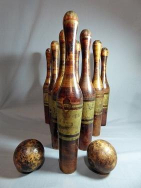 An Antique Parcel Gilt Carved Wood Skittles Set