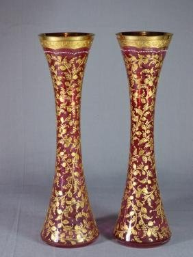 Pair of Gilt Enameled Moser Cranberry Glass Vases