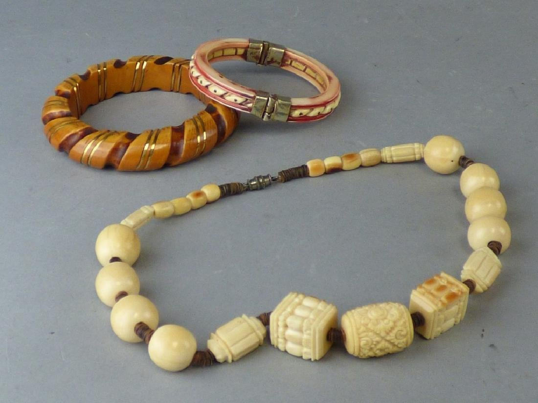 Group of Three Various Carved Jewelry Articles