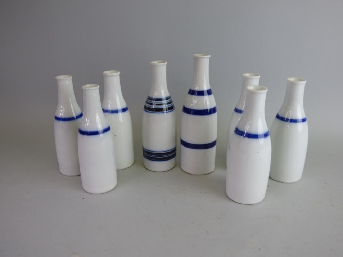 Group of Eight B/W Porcelain Sake Tokkuri