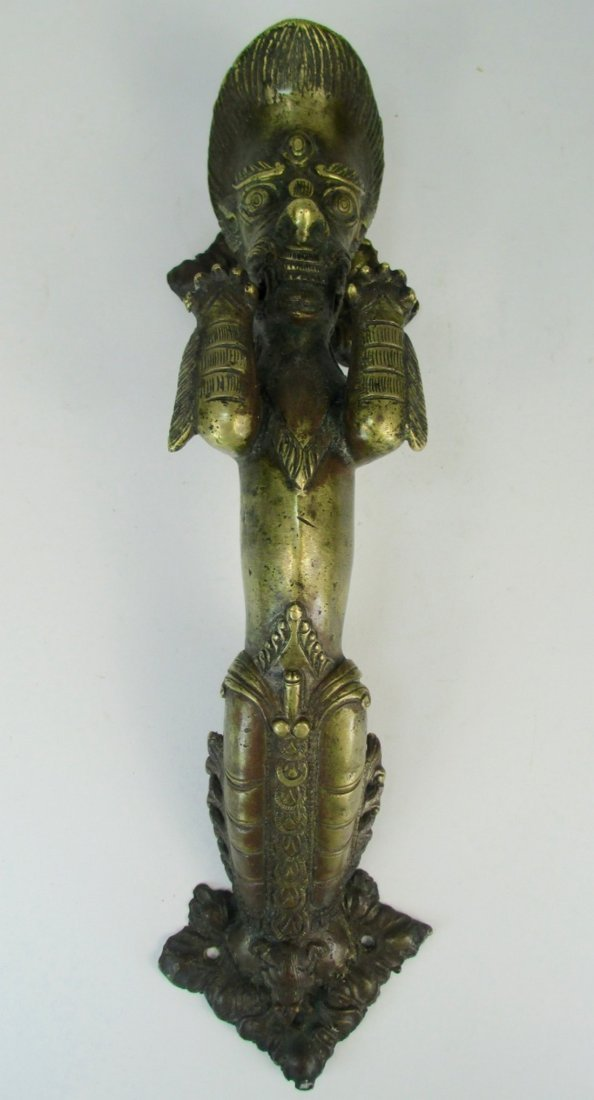 An unusual brass door handle - 6