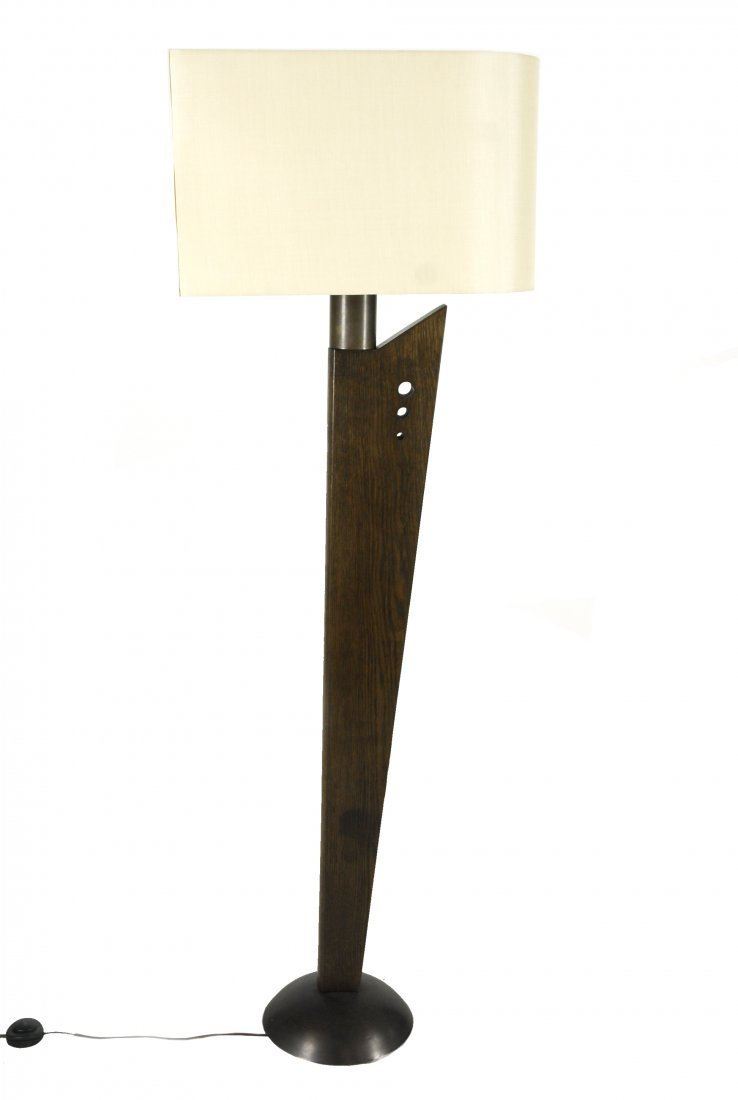 Wooden floor lamp in the style of Russel Wright
