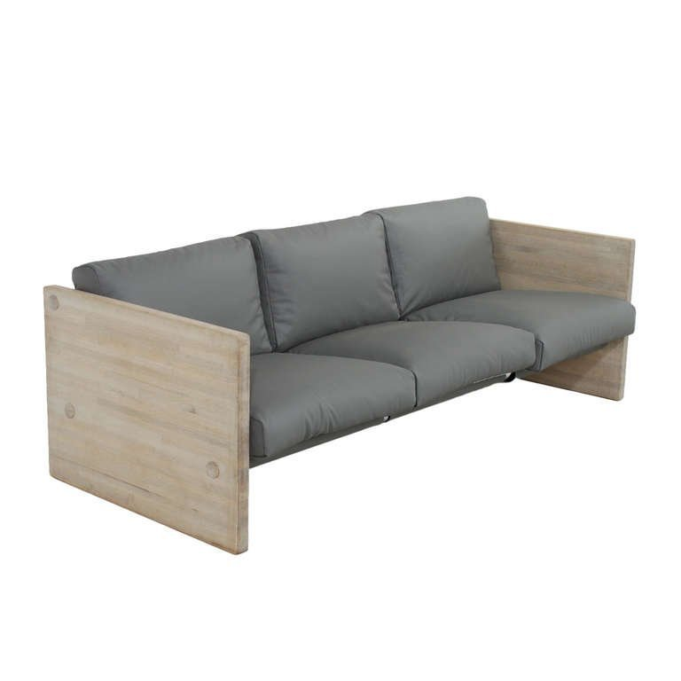 Modernist leather and oak sofa