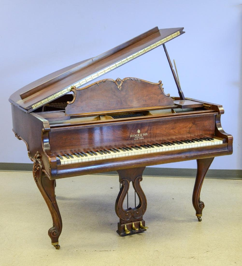Decker and Co walnut Louis XIV style baby grand piano,