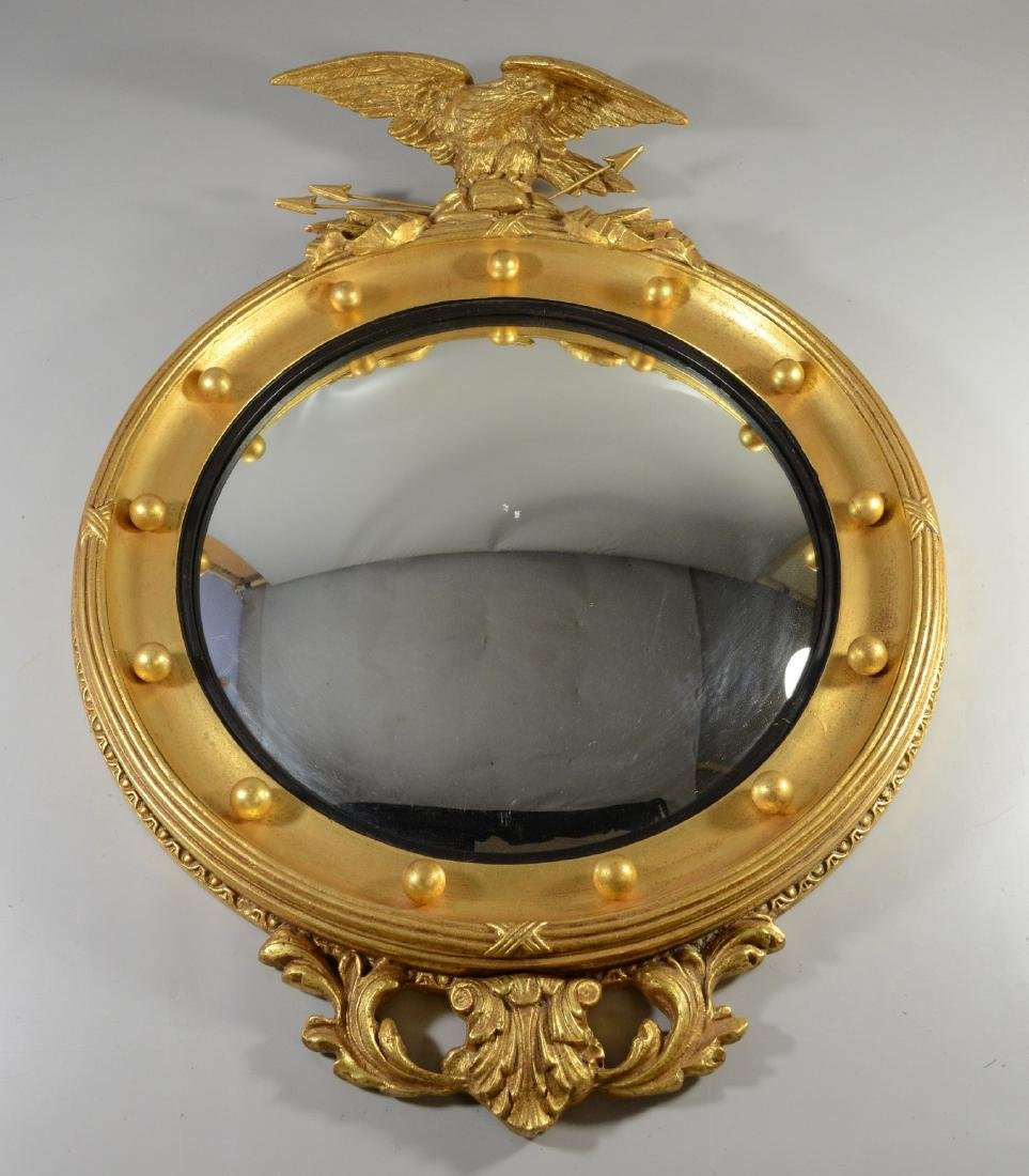 Circular girandole mirror with eagle and arrows at top,