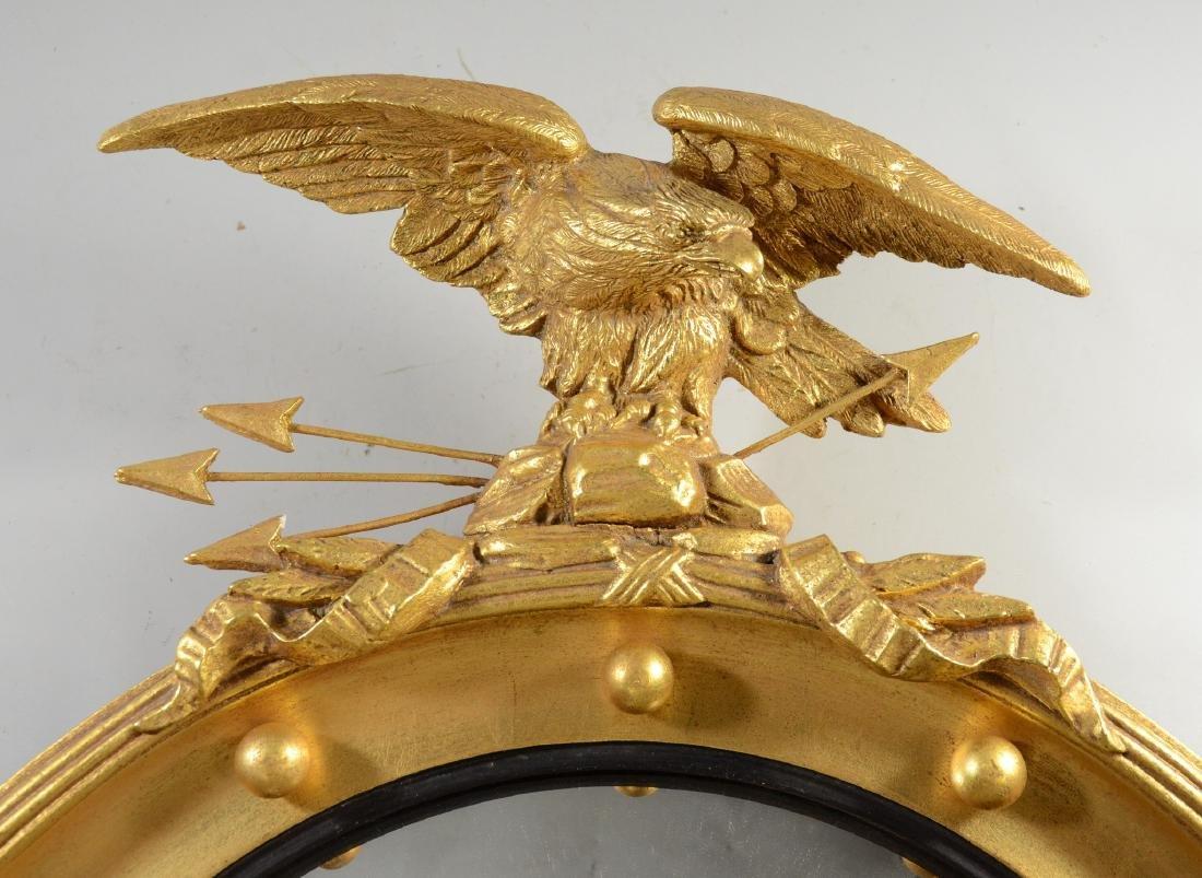 Circular girandole mirror with eagle and arrows at top, - 2