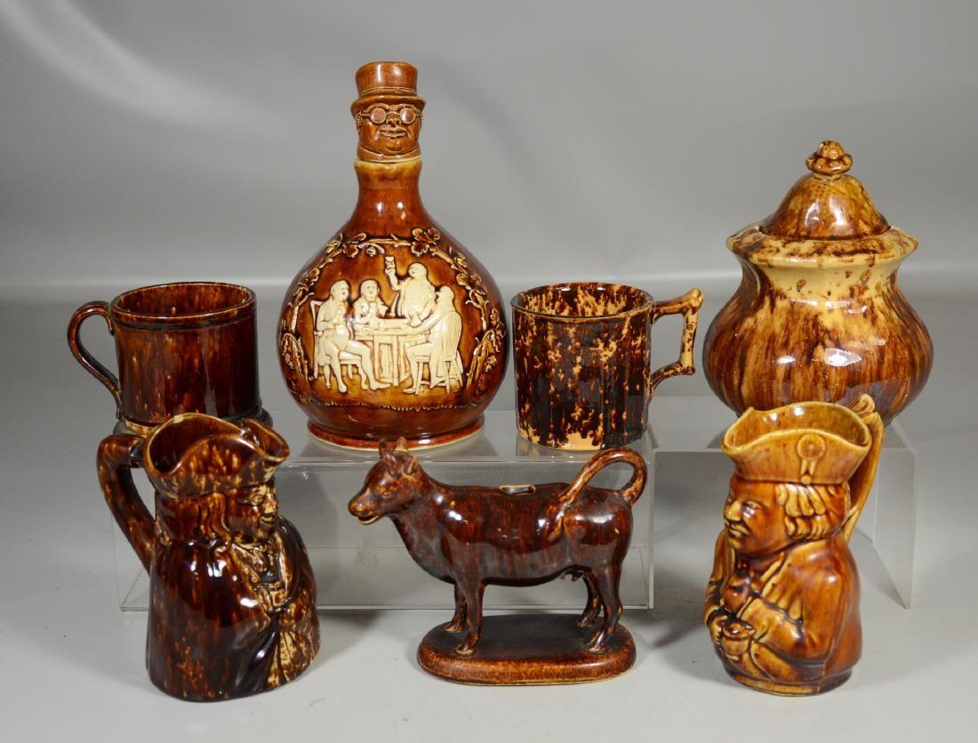 Seven (7) pieces of Rockingham Bennington style pottery