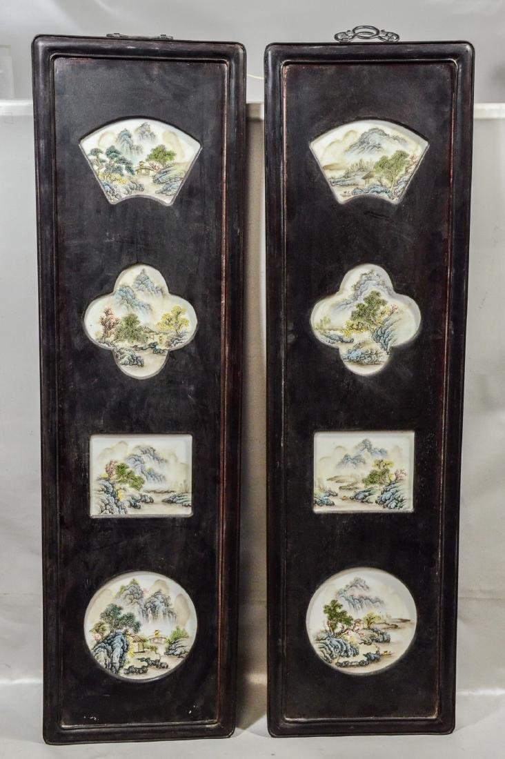 Pair of Chinese teak wood framed porcelain plaques,