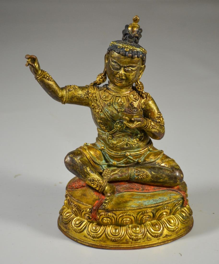 Tibetan gilt bronze figure holding a kapala cup, with