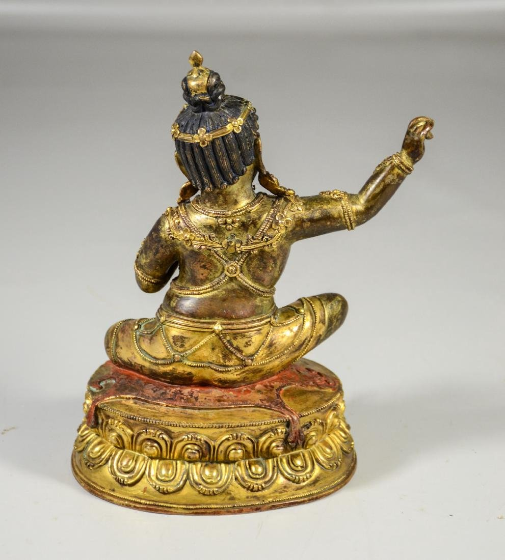 Tibetan gilt bronze figure holding a kapala cup, with - 3
