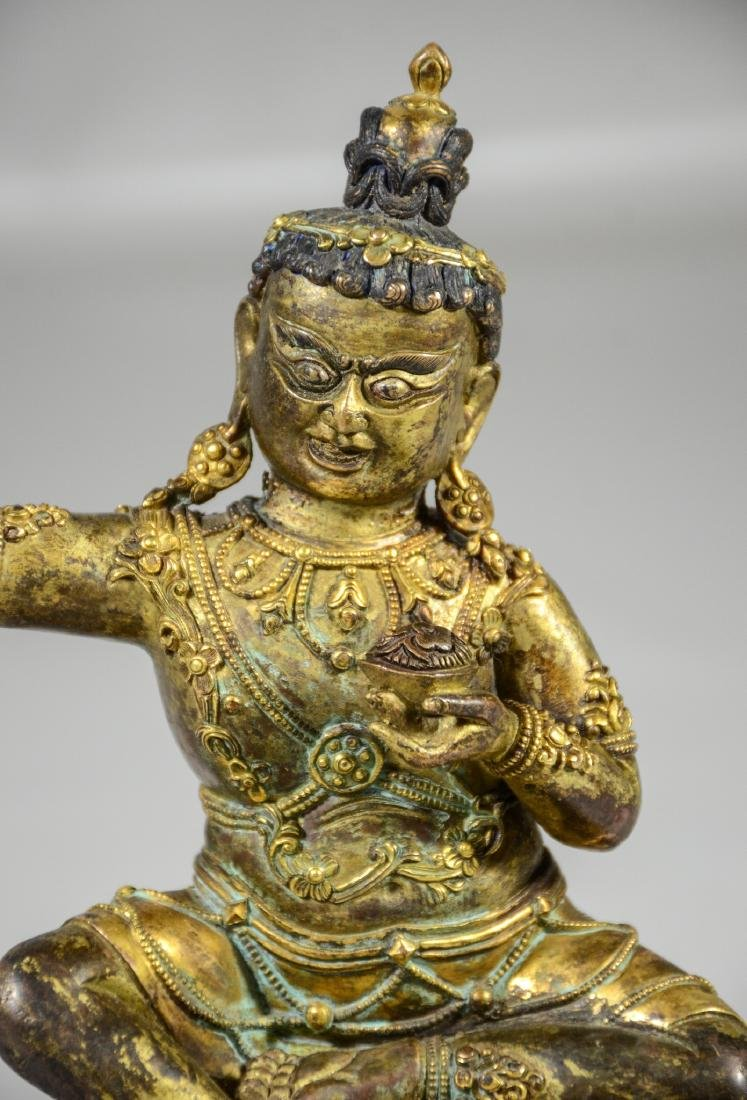 Tibetan gilt bronze figure holding a kapala cup, with - 6