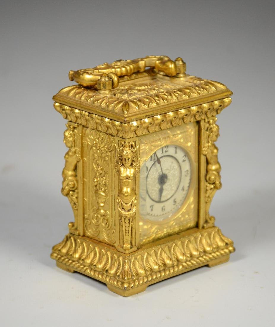 Continental gilt carriage clock, caryatid column
