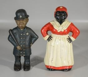 Two Reproduction Cast Iron Piggy Banks