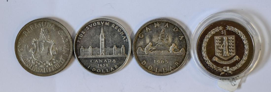 (2) Canadian silver Dollars, (1) British Virgin Islands - 2