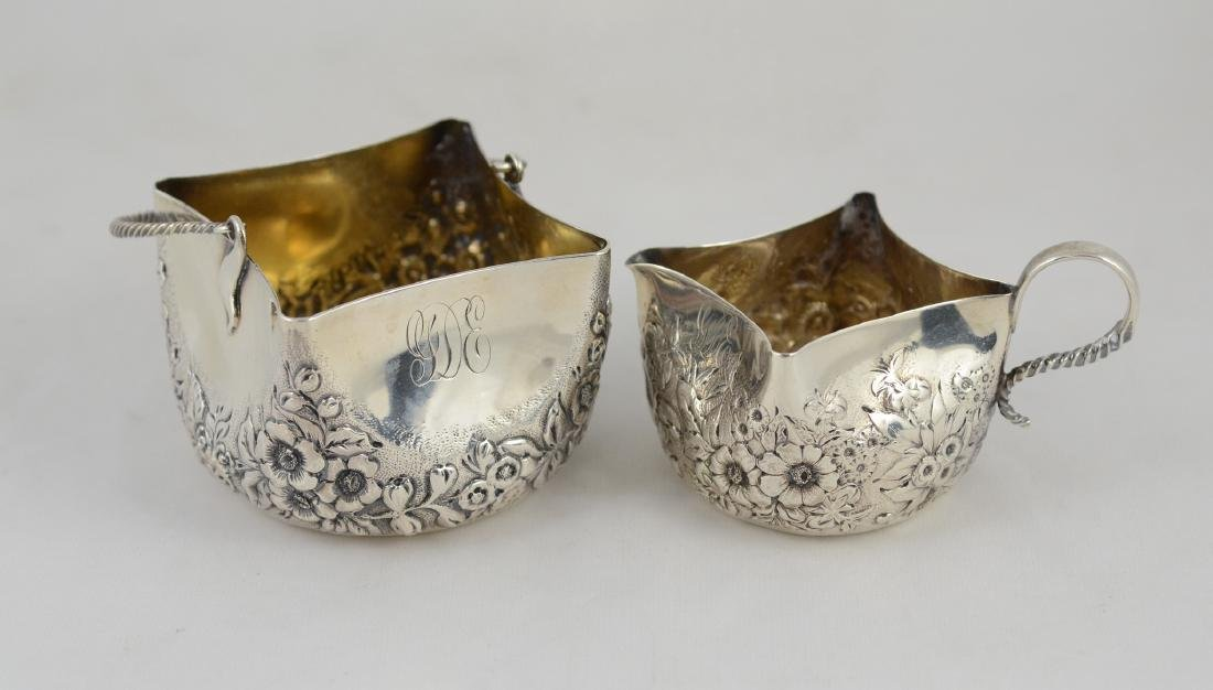 Sterling repousse creamer & sugar with gilt interior