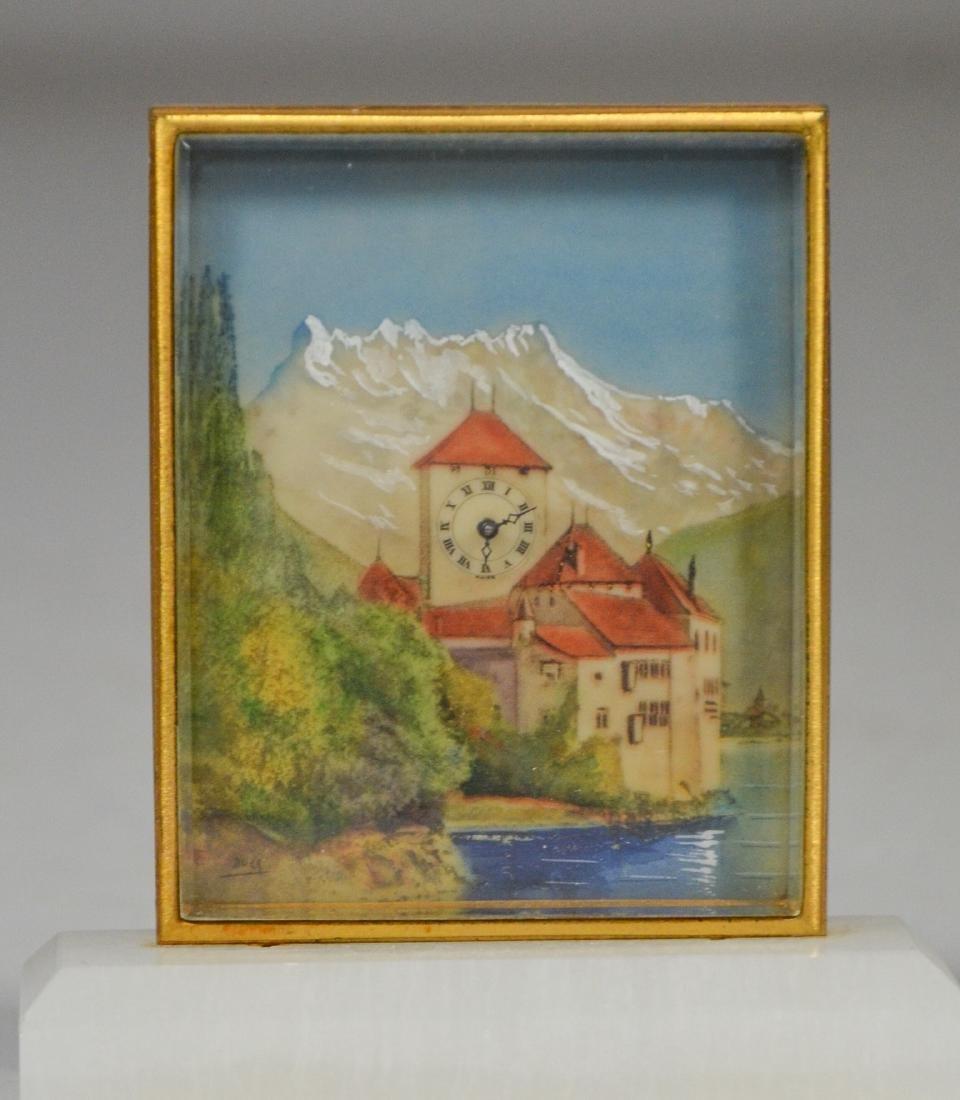 Diminutive clock with Swiss scene