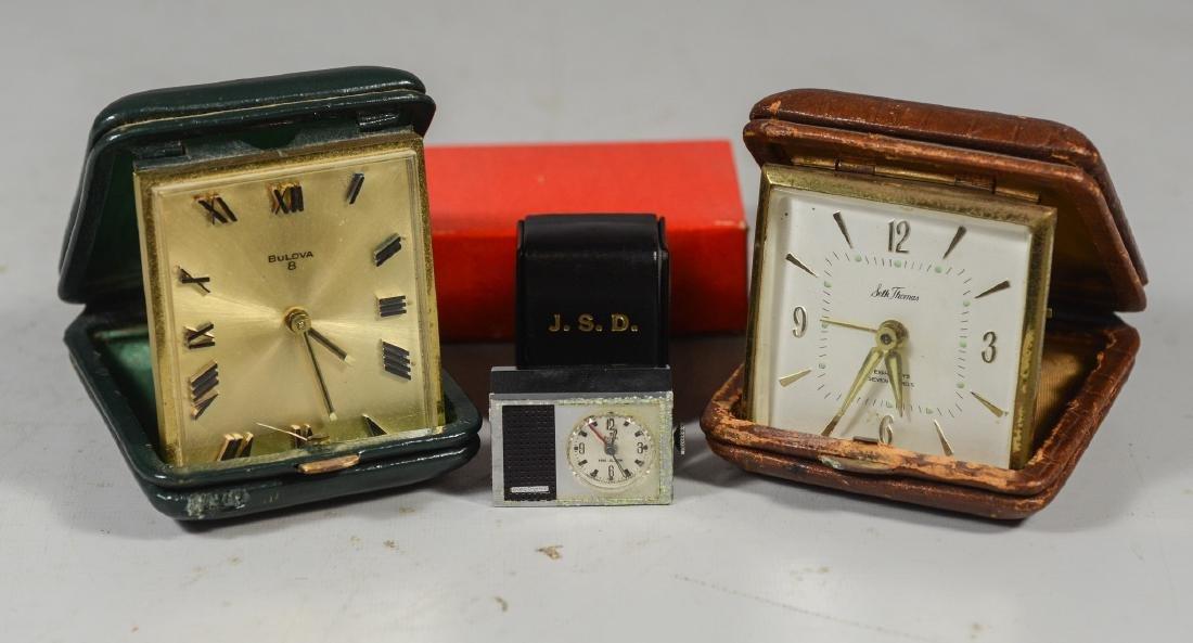 3 Travel alarm clocks