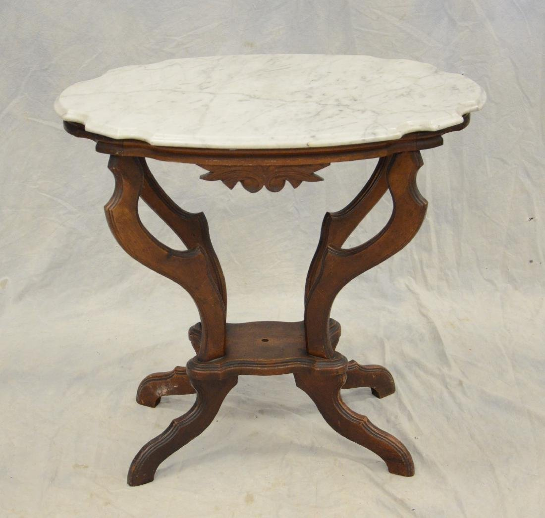 Walnut Victorian turtle shaped marble top table