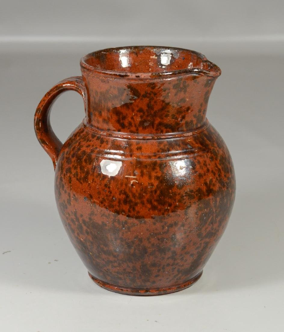 Redware pitcher with manganese glaze, possibly