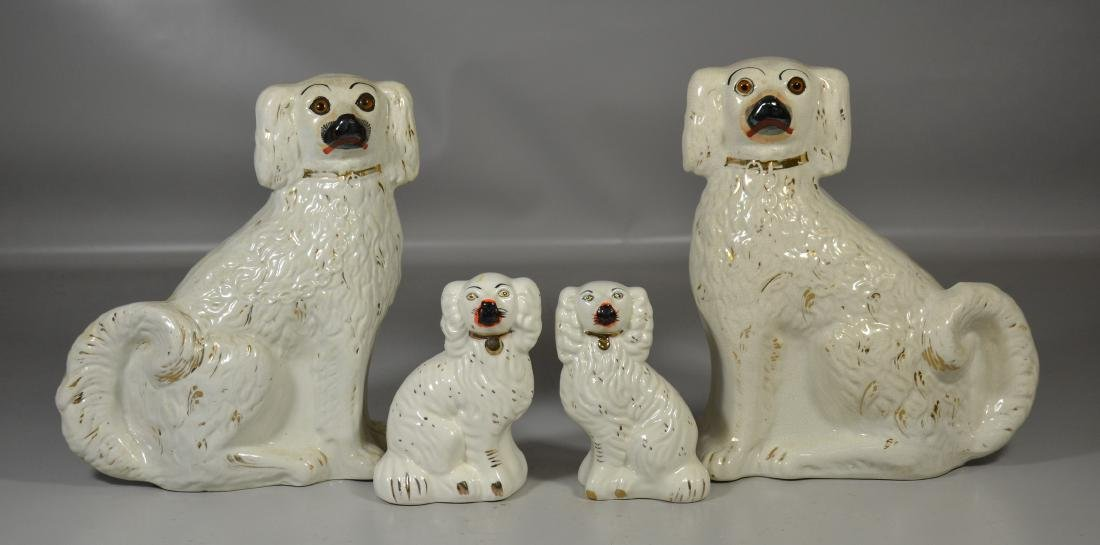 Two pair of Staffordshire style dogs