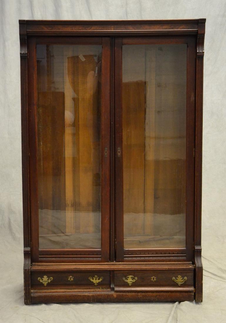 Eastlake Victorian walnut 2-door bookcase