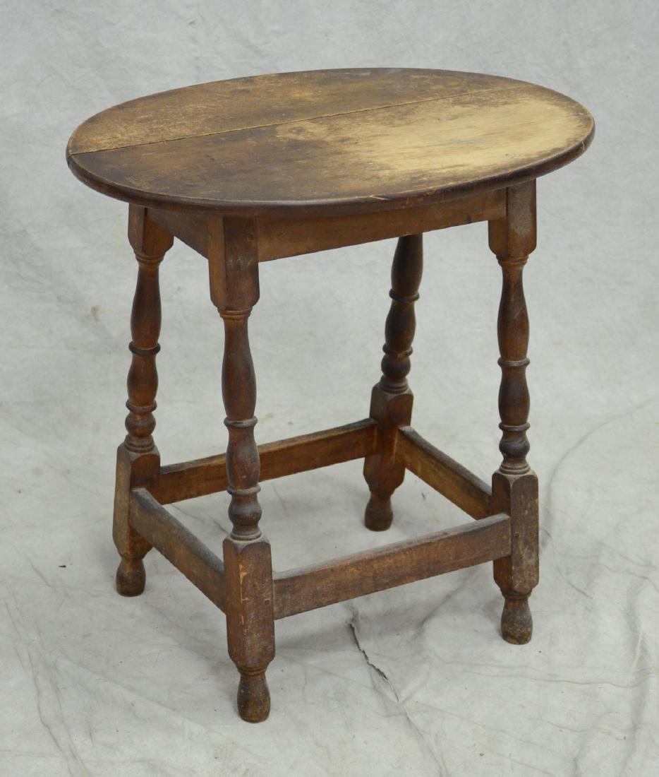 Oval walnut William & Mary style tavern table