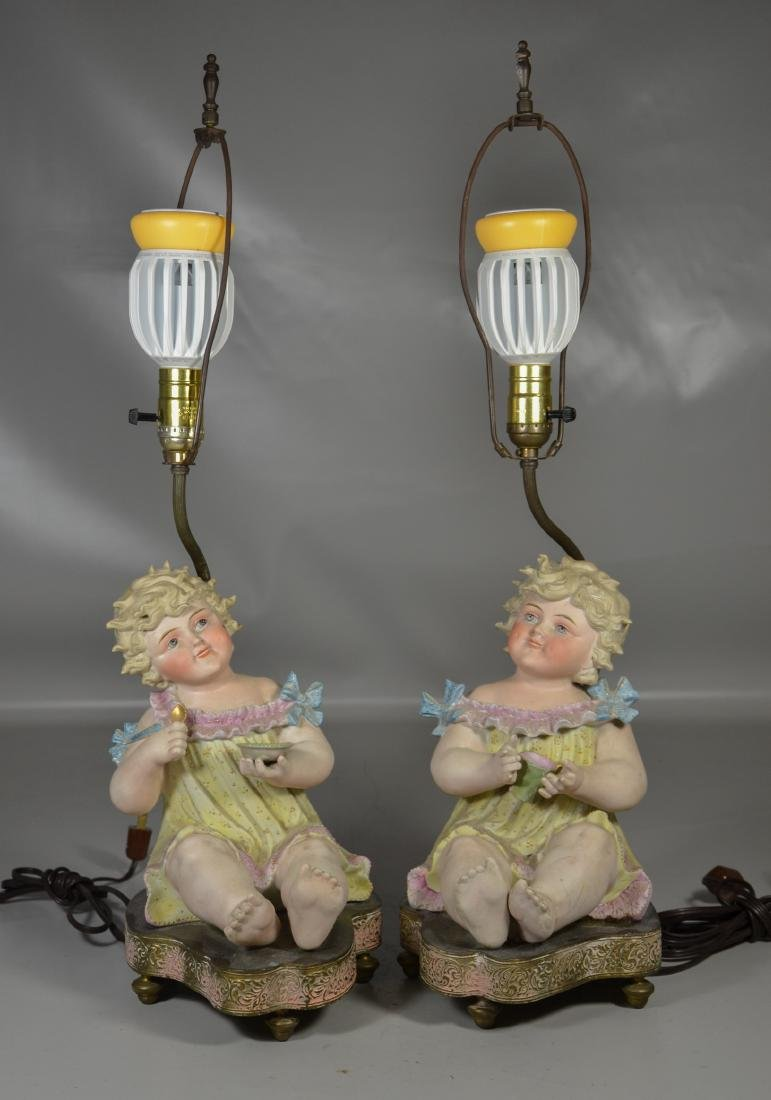Pr Continental bisque children mounted as lamps