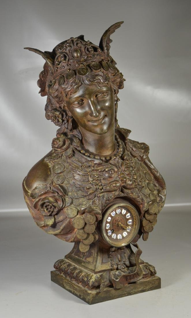 Patinated white metal French clock, bust of Fortuna