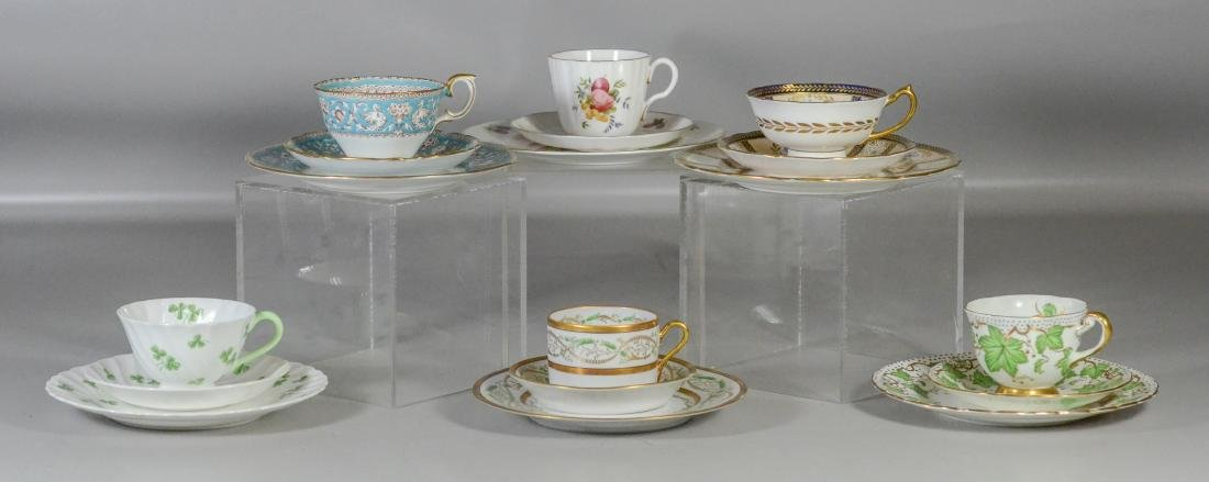 (6) Porcelain trio sets, each with cup, saucer and