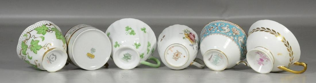 (6) Porcelain trio sets, each with cup, saucer and - 2