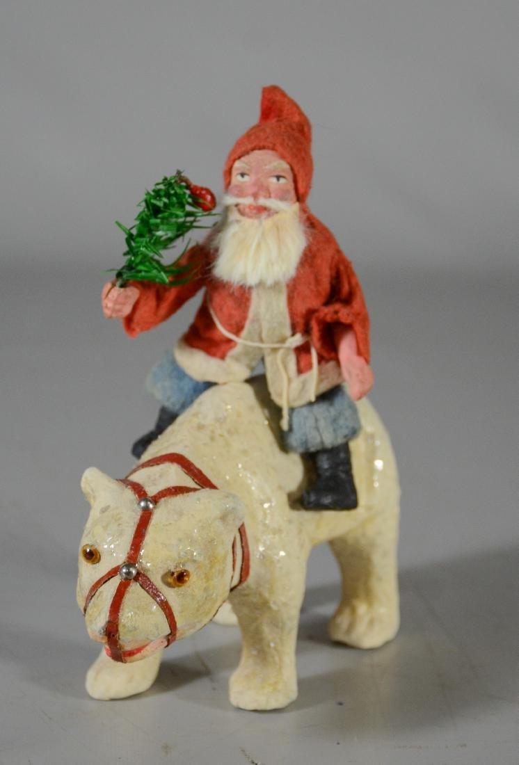 Santa Claus riding on a composition polar bear, glass