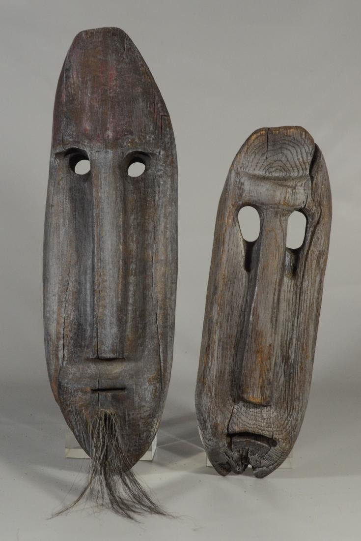 (2) Ray Faunce carved wood tribal masks, both dated