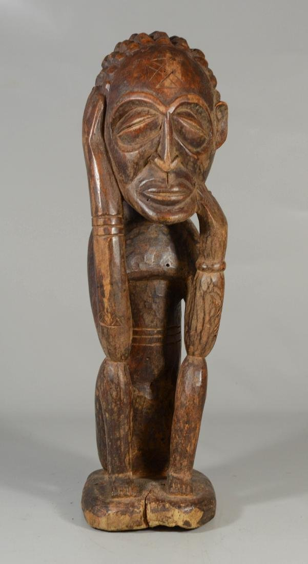 African Chokwe carved wood seated figure, Angola or the